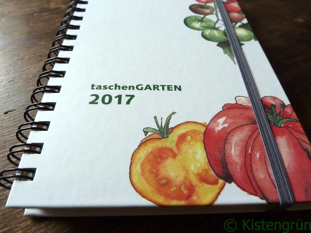 Gartenkalender Taschengarten auf einem braunen Holztisch